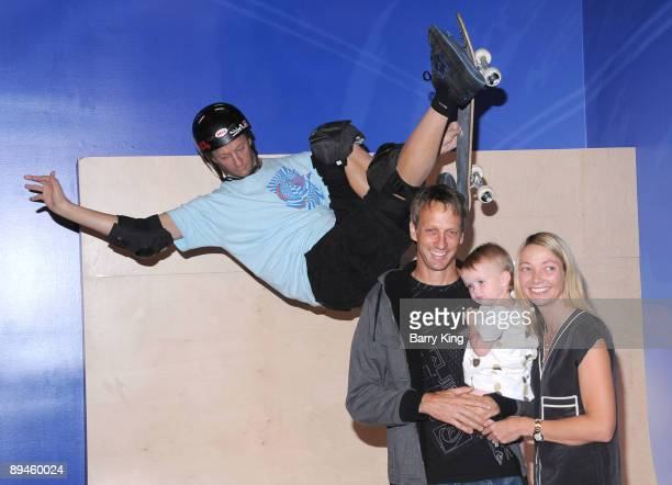 Former professional skateboarder Tony Hawk with his wife Lhotse Merriam and their daughter Kadence Clover Hawk attend the unveiling of Hawk's wax...
