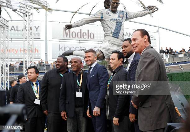 Former professional soccer midfielder David Beckham poses for a photo with his statue at Dignity Health Sports Park on March 02 2019 in Carson...