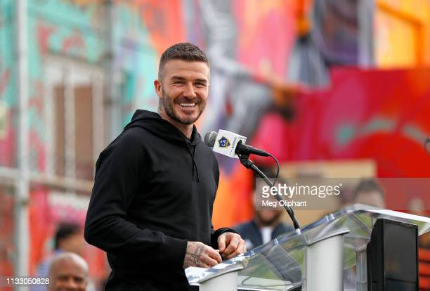 Former professional soccer midfielder David Beckham speaks at the unveiling of a community soccer field at Red Shield Community Center on March 01,...