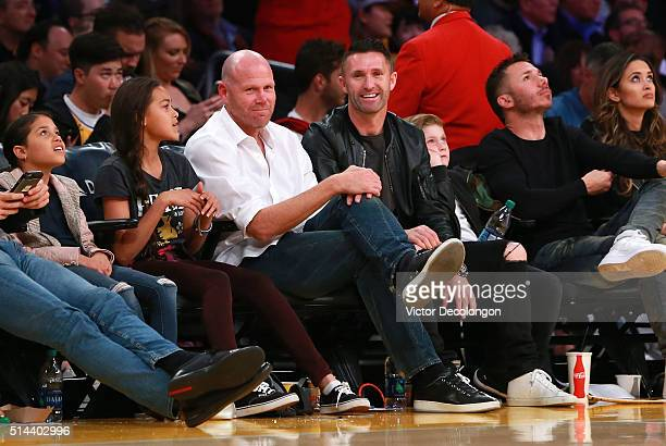 Former professional soccer player Brad Friedel and current professional soccer player Robbie Keane of the Los Angeles Galaxy attend the NBA game...