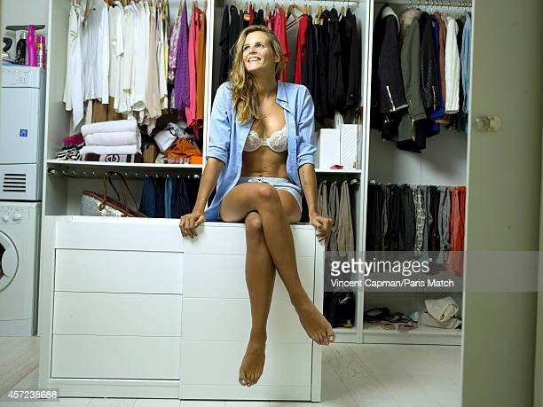 Former professional swimmer Laure Manaudou is photographed at home for Paris Match on October 3 2014 in Marseille France