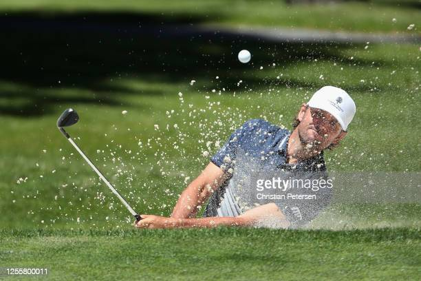 Former professional tennis athlete Mardy Fish chips from the bunker onto the 17th green during the final round of the American Century Championship...