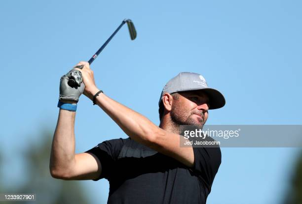 Former professional tennis athlete Mardy Fish tees off from the first hole during the final round of the American Century Championship at Edgewood...