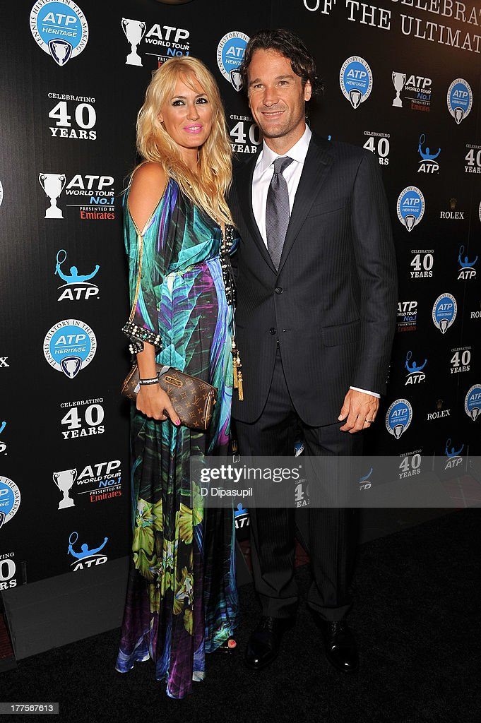 Former professional tennis player Carlos Moya (R) and wife Carolina Cerezuela attend the ATP Heritage Celebration at The Waldorf=Astoria on August 23, 2013 in New York City.