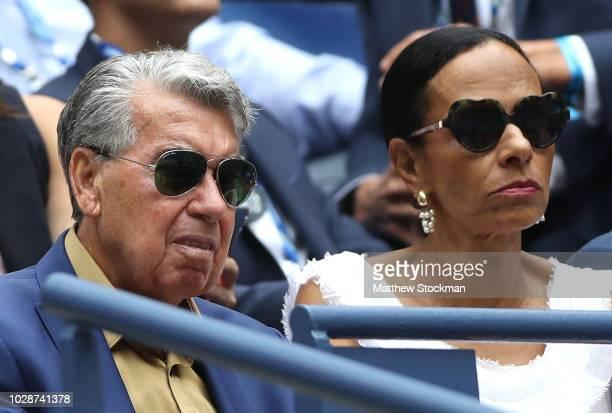Former professional tennis player Manuel Santana watches the men's singles semifinal match between Rafael Nadal of Spain and Juan Martin del Potro of...