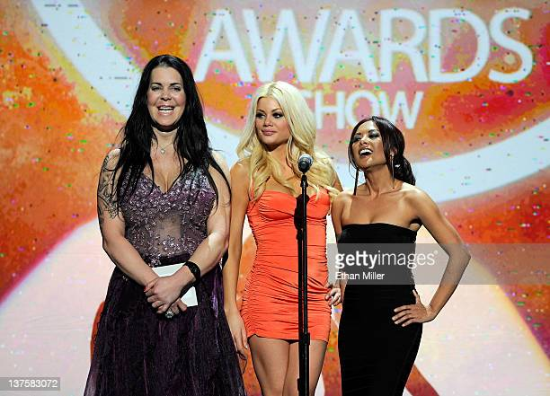 Former professional wrestler and adult film actress Chyna and adult film actresses Riley Steele and Kaylani Lei present an award during the 29th...