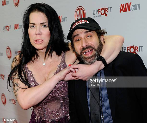 Former professional wrestler and adult film actress Chyna jokes around with comedian and show cohost Dave Attell as they arrive at the 29th annual...
