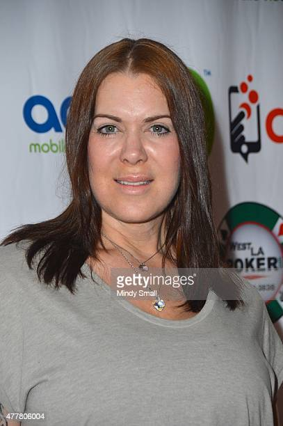 Former professional wrestler Joanie Chyna Laurer arrives at the Raising the Stakes for Cerebral Palsy Celebrity Poker Tournament at Planet Hollywood...