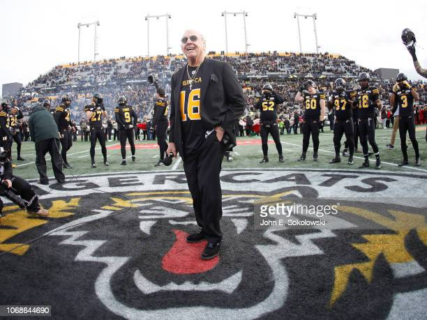 Former professional wrestler Ric Flair stands with the Hamilton Tiger-Cats prior to the start of the Eastern Semi-Final game against the BC Lions at...