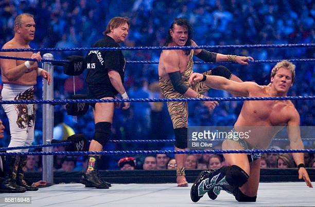 Former professional wrestlers Ricky 'The Dragon' Steamboat and 'Rowdy Roddy Piper look on as Jimmy 'Superfly' Snuka steps into the ring to battle WWE...