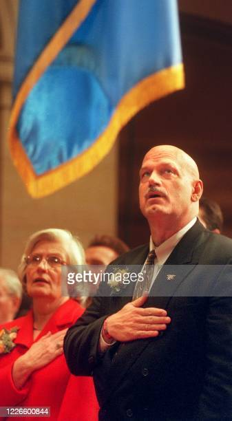 Former professional wrestling bad guy and Minnesota state's Governor-elect Jesse Ventura and Lt. Governor-elect Mae Schunk recite the Pledge of...