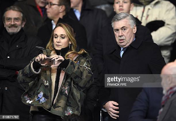 Former PSG coach Carlo Ancelotti and his wife Mariann Barrena McClay attend the Champions League round of 16 first leg football match between Paris...