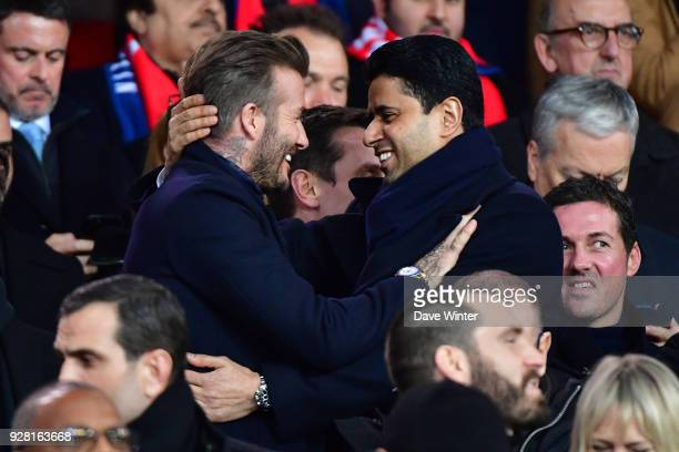 Former PSG player David Beckham is greeted byPSG president Nasser AlKhelaifi during the UEFA Champions League Round of 16 second leg match between...