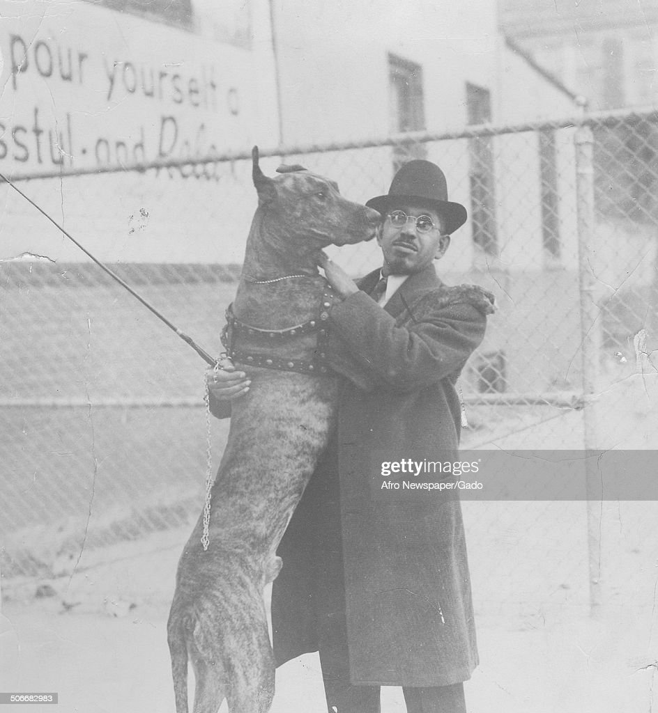 Former publisher of the Afro American Newspapers John H Murphy Jr and a show dog, 1941.