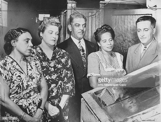 Former publisher of the Afro American Newspapers John H Murphy Jr observing newspaper printing equipment 1946