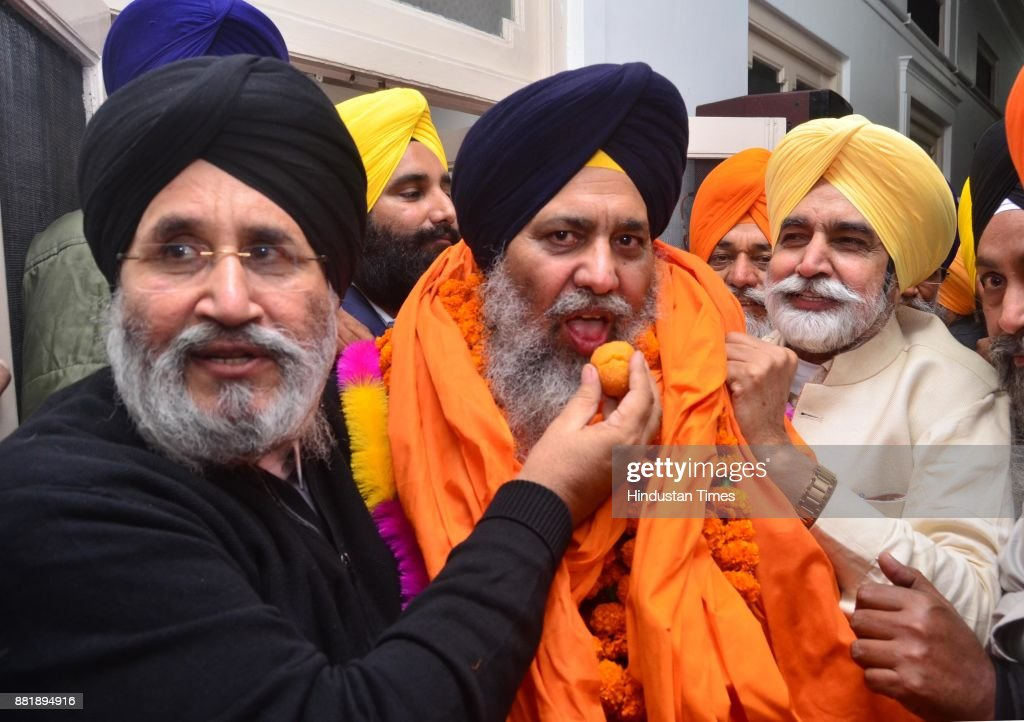 former Punjab cabinet Minister and Senior SAD leader Daljeet Singh Cheema and former Punjab cabinet Minister Sikander Singh Maluka offering sweet to..