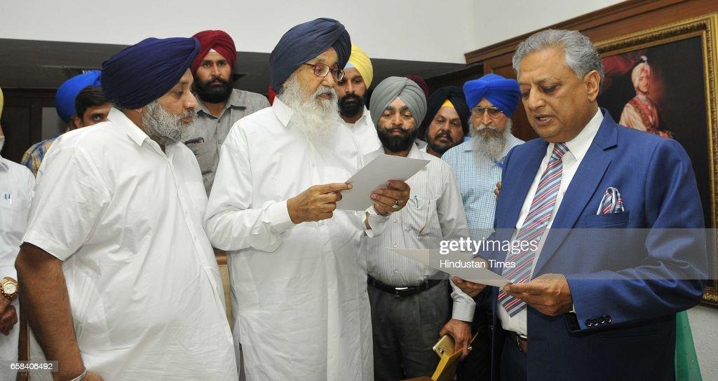 Former Punjab CM Parkash Singh Badal and Sukhbir Singh Badal taking oath in Speaker office at Punjab Vidhan Sabha on March 27 2017 in Chandigarh India