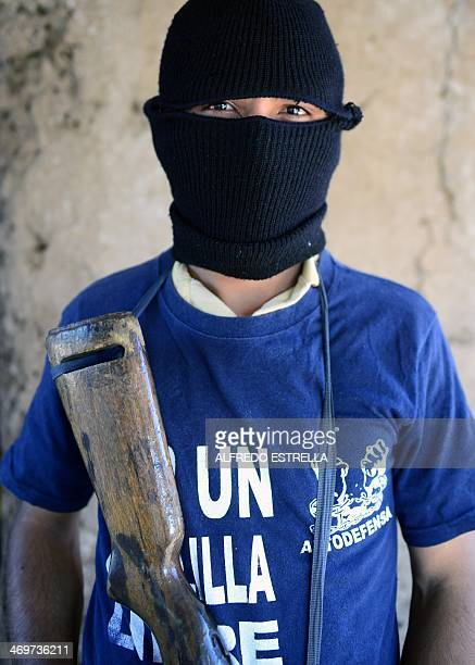 A former puntero of the Templar Knights drug cartel poses during an interview with AFP at la Nopalera community Michoacan state Mexico on February 15...