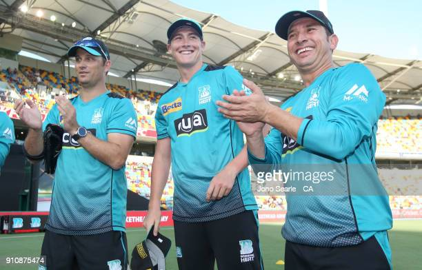 Former QLD player Heat player Matthew Renshaw smiles after getting his Heat cap during the Big Bash League match between the Brisbane Heat and the...