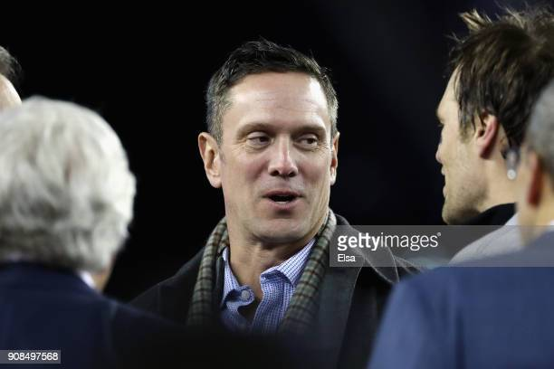 Former quarterback Drew Bledsoe of the New England Patriots talks with Tom Brady of the New England Patriots afterthe AFC Championship Game against...