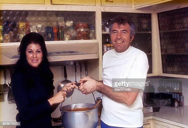 Former race car driver and car designer and manufacturer Carroll Shelby cooks Chili at home for his ex-wife Jeanne and daughter Sharon circa 1966.