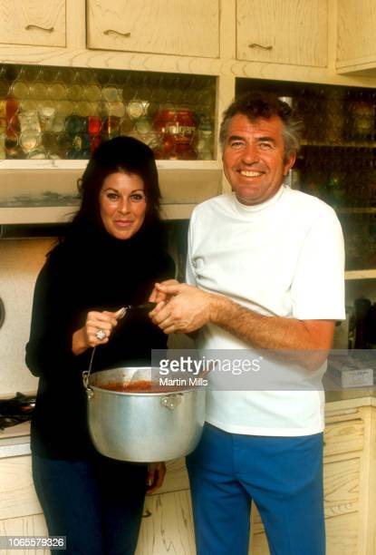 Former race car driver, car designer and manufacturer Carroll Shelby cooks chili at home for his ex-wife Jeanne Fields circa 1966 in Los Angeles,...