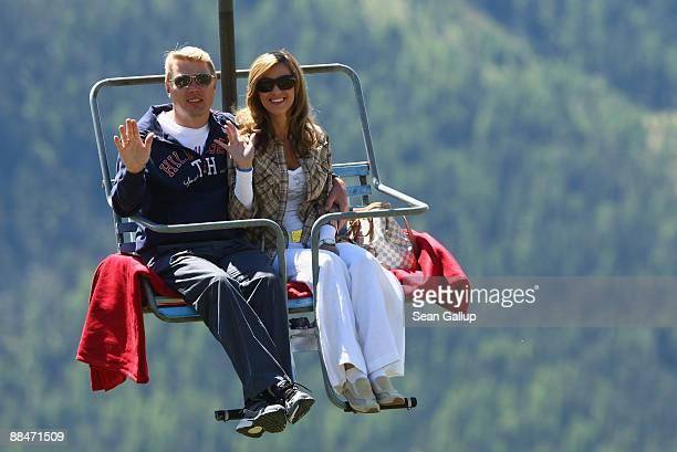 Former race car driver star Mika Hakkinen and his girlfriend Marketa Kromatova ride a ski lift to the wedding brunch reception of former tennis star...