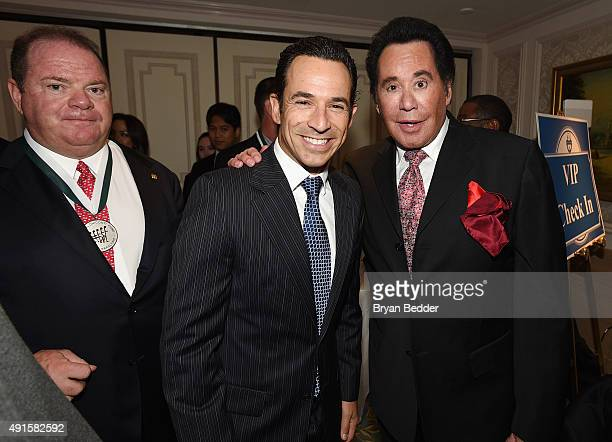 Former Racing Driver Chip Ganassi, Auto Racing Driver Helio Castroneves and singer Wayne Newton attend the 30th Annual Great Sports Legends Dinner to...