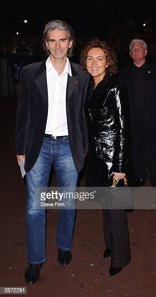 """Former racing driver Damon Hill and his wife Georgie arrive at the DVD screening of """"A Concert For George,"""" a tribute to the late George Harrison at..."""