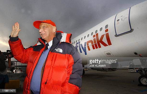 Former racing driver Niki Lauda poses in front of his new Airbus 320 at Vienna International airport 28 November 2003 shortly after the inauguration...