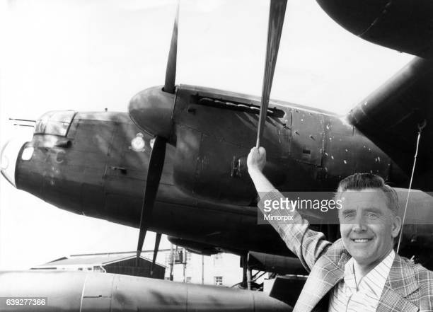 Former RAF flight engineer Alan Morgan in Lancasters, poses beside one of the famous Avro Lancaster bombers at the gate at RAF Scampton. 20th May...