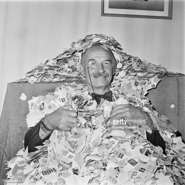 Former RAF officer Sir William Coles covered in stamps from letters, UK, 25th September 1972. He was President of the Not Forgotten Association from...