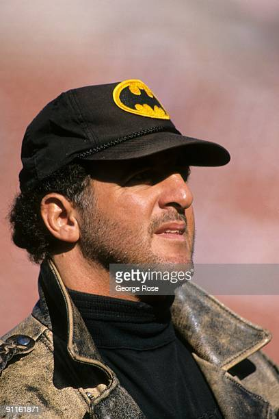 Former Raider Lyle Alzado looks on at the game between the Los Angeles Raiders and the New England Patriots at the Los Angeles Memorial Coliseum on...