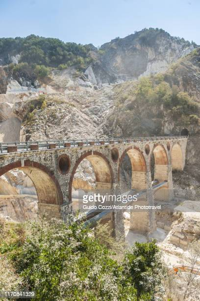 former railway bridge that served marble quarry near colonnata - image stock pictures, royalty-free photos & images