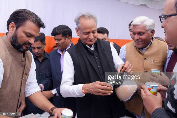 Former Rajasthan chief minister Ashok Gehlot serves tea to the Congress party workers and guests while celebrating Rajasthan Assembly election...