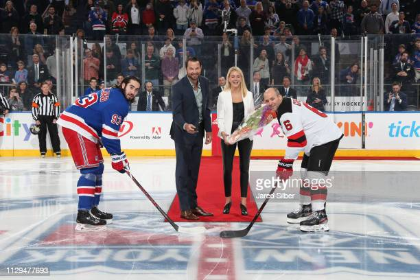 Former Rangers player Rick Nash drops the ceremonial puck to Mika Zibanejad and Andy Greene prior to the game between the New York Rangers and the...