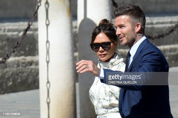 TOPSHOT Former Real Madrid midfielder David Beckham and his wife Victoria Beckham arrive at the Cathedral of Seville on June 15 2019 to attend the...