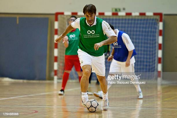 Former Real Madrid player Rafael Martin Vazquez takes part in a charity football match with cerebral palsy sufferers at the Spanish Superior Sports...