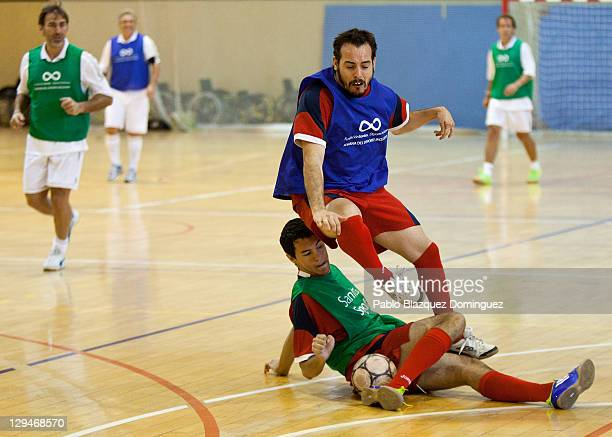 Former Real Madrid player Rafael Martin Vazquez watches two players battling for the ball during a charity football match with cerebral palsy...