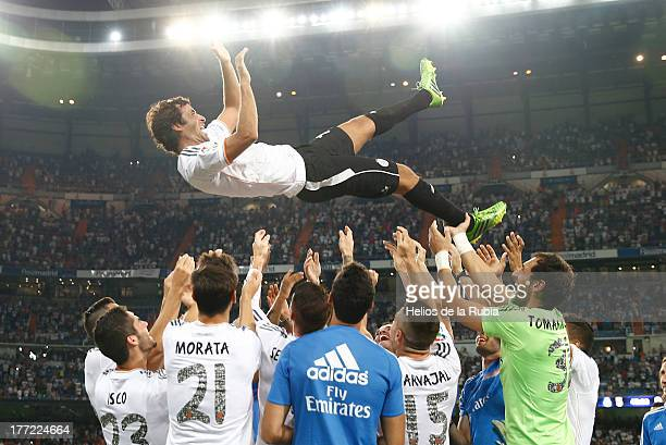 Former Real Madrid player Raul Gonzalez is thrown in the air by current team members after the Santiago Bernabeu Trophy match between Real Madrid CF...