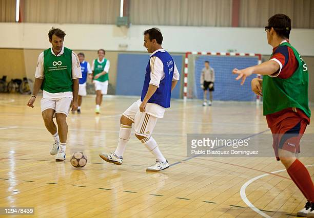 Former Real Madrid players Rafael Martin Vazquez and Ivan Perez take part in a charity football match with cerebral palsy sufferers at the Spanish...