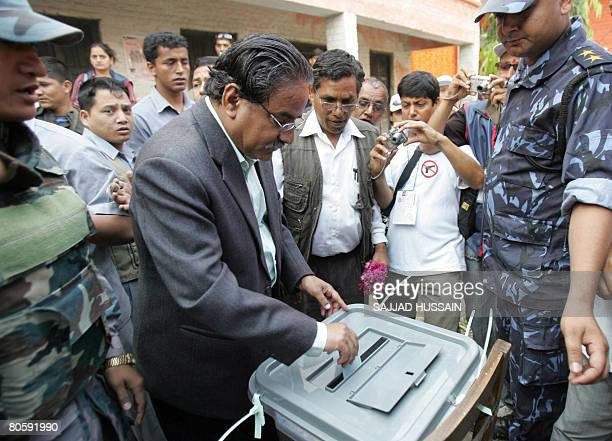 Former rebel leader and present chairman of the Nepal Communist Party Maoist Pushpa Kamal Dahal known as Prachanda cast his vote at a polling station...