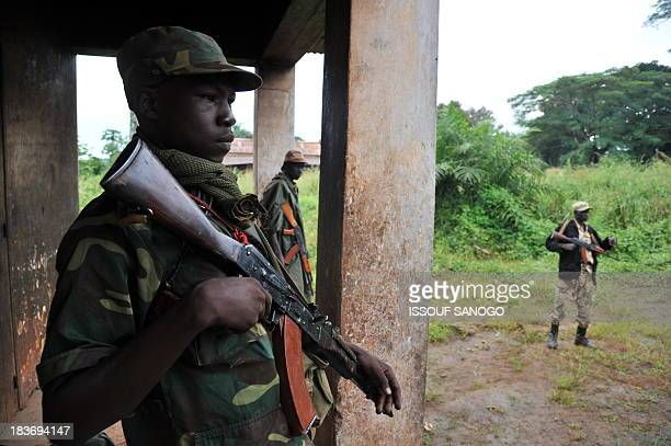 Former rebels of the Seleka coalition guard on October 8 2013 in a building a group of men who were arrested after pretending to be Seleka rebels in...