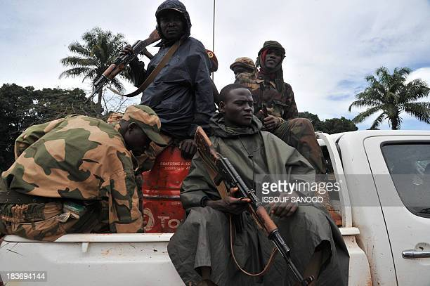 Former rebels of the Seleka coalition patrol on October 8 2013 in Bangassou The Central Africa Republic has been shaken by a recent increase in...