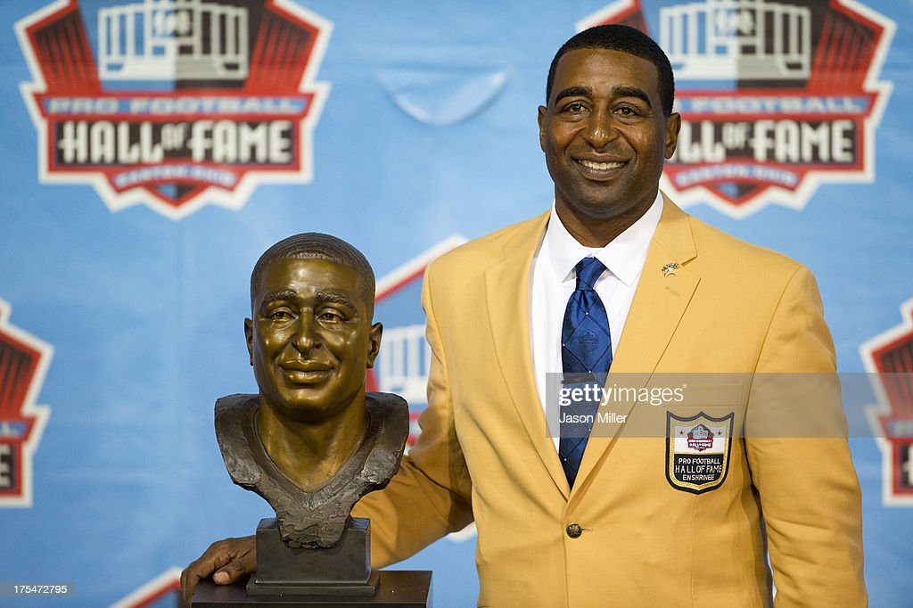 Former receiver Cris Carter of the Minnesota Vikings poses with his bust during the NFL Class of 2013 Enshrinement Ceremony at Fawcett Stadium on Aug. 3, 2013 in Canton, Ohio.