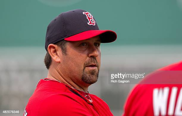 Former Red Sox catcher Jason Varitek talks to a member of the Red Sox coaching staff before a game at Fenway Park between the Boston Red Sox and the...