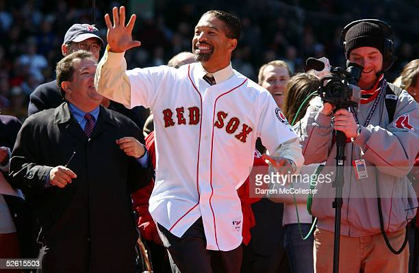 Former Red Sox pinch runner Dave Roberts waves to the crowd April 11 2005 while receiving his championship ring at Fenway Park in Boston...