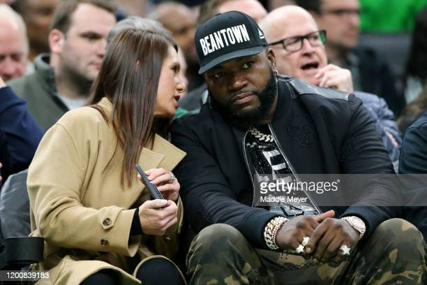 Former Red Sox player David Ortiz and his wife Tiffany sit courtside for the game between the Boston Celtics and the Los Angeles Lakers at TD Garden...