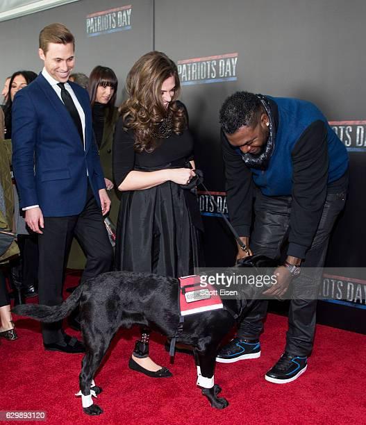 Former Red Sox player David Ortiz greets the assistance dog of Boston Marathon Bombing survivor Jessica Downes alongside her husband Patrick Downes...