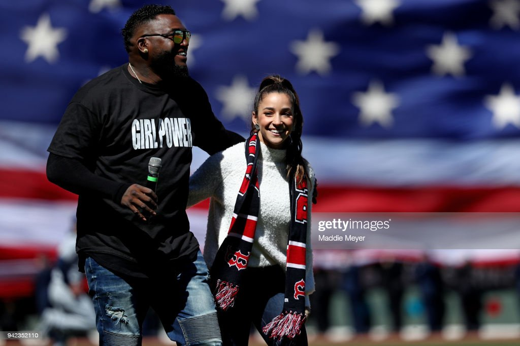Former Red Sox player David Ortiz with American Olympic gymnast Aly Raisman before the Red Sox home opening game against the Tampa Bay Rays at Fenway Park on April 5, 2018 in Boston, Massachusetts.
